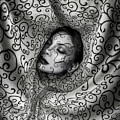 Woman Surrounded By Cloth Of Paisley Prints by Erich Caparas