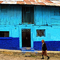 Woman Walking By The Blue House by Mexicolors Art Photography