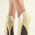 Woman Wearing High Heel Shoes by Oleksiy Maksymenko