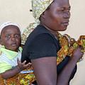 Woman With A Baby In Tanzania by Marek Poplawski