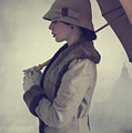 Woman With Vintage Cloche Hat Overcoat And Umbrella In Rain by Lee Avison
