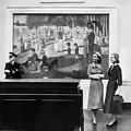 Women View Seurat Painting In Museum by Horst P Horst