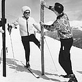 Women Waxing Skis by Underwood Archives