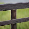 Wood Railing Over The Marsh by Dale Powell