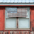 Wooden American Flag On Red Barn by Catherine Sherman