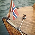 Wooden Boat With Norwegian Flag by Michelle Calkins