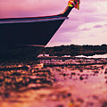 Wooden Fishing Thai Boat Sunken On The Rocky Beach During Tide by Srdjan Kirtic