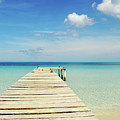 Wooden Pier On A Perfect Tropical Caribbean White Sand Beach by Srdjan Kirtic