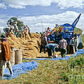 Workers Loading Rice by Inga Spence
