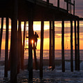 Working On The Pier At Dawn by Robert Banach
