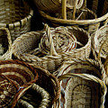 Woven Baskets For Sale At A Market by Todd Gipstein