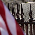 Wrought Iron And American Flag by Colleen Cornelius