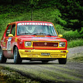 Yellow And Red Fiat 127 by Alain De Maximy