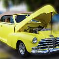 Yellow Antique Restored Automobile by Bob Slitzan
