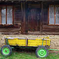 Yellow Cart And Green Wheels  by Cliff Norton