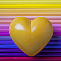 Yellow Heart On Row Of Colored Pencils by Garry Gay