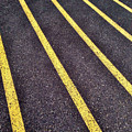 Yellow Lines On Athletic Running Track by Bryan Mullennix