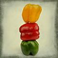Yellow Red And Green Bell Pepper by Bernard Jaubert