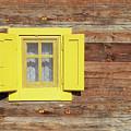 Yellow Window On Wooden Hut Wall by Goce Risteski