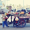 Young Boy Fruit Seller by Yara S
