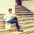 Young Businessman Sitting On Stairs, Relaxing Outside by Alexander Image