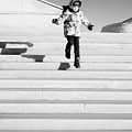 Young Child Jumping Down Steps by John Williams