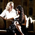 Young Couple Outdoors At A Mansion On A Couch In Harsh High Cont by Reimar Gaertner