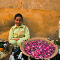 Young Girl Selling Rose Petals In The Medina Of Fes Morroco by David Smith