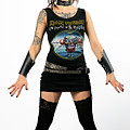 Young Heavy Metal Female Punk Fan Standing Tall With Horns Pierc by Reimar Gaertner