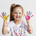 Young Kid Showing Her Colorful Hands by Michal Bednarek