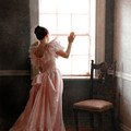 Young Lady In Pink Gown Looking Out Window by Jill Battaglia