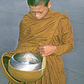 Young Monk Begging Alms And Rice, Thailand by Buddy Mays