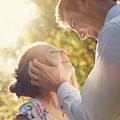Young Romantic Couple Flirting In Sunshine by Michal Bednarek