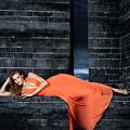 Young Woman In Long Orange Dress by Oleksiy Maksymenko