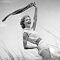 Young Woman Waving Scarf, C.1950-60s by H Armstrong Roberts and ClassicStock