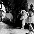 Ballerinas At Barre Against Round Window by Alfred Eisenstaedt