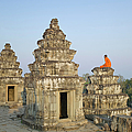 Buddhist Monks Amongst Temple Ruins by Martin Puddy