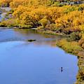 Distant Fisherman On The San Juan River In Fall by Brenda Landdeck