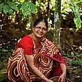 Female Coffee Farmer Harvesting Coffee by Simon Rawles