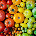 Fresh Heirloom Tomatoes Background by Letterberry