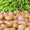 Piles Of Potatoes And Green Peppers by Steve Estvanik