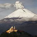 Snowy Volcano And Church by Cristobal Garciaferro