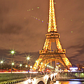 The Eiffel Tower Lit Up At Night In by Julian Elliott Photography