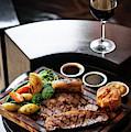 Sunday Roast Beef Traditional British Meal Set On Table by Jacek Malipan