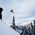 A Athletic Skier Jumping Off A Cliff In by Patrick Orton