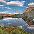 A Calm Mountain Lake by Leland D Howard