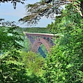 A Nature Framed View Of New River Gorge Bridge West Virginia by Lisa Wooten