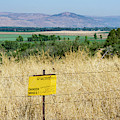 A Sign Warns Of Uncleared Mines In The Golan Heights, Israel. by William Kuta