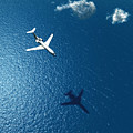 Airplane Flies Over A Sea by Photobank Gallery
