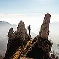 Alpinist Admires The Mountain Landscape by Deimagine
